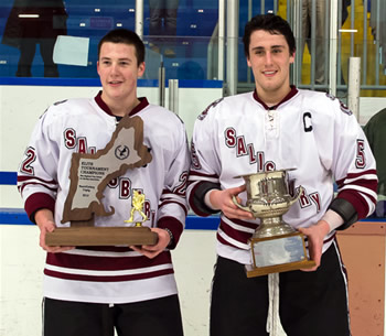 Salisbury co-captains Ryan Segalla (22) and Mark Hamilton (5) hold the hardware after Sunday's championship game.