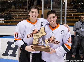 KUA co-captains AJ Greer and JD Dudek display some hardware after winning Sunday's Small School title with a 5-1 win over Dexter