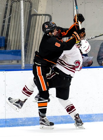 KUA senior F Mike Lombardi (8) plays the body. He also played the puck, scoring 2 goals (including an empty-netter) and adding an assist to lead the W