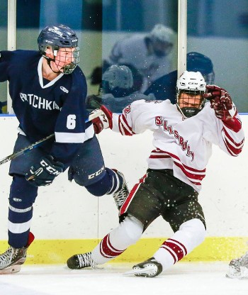 Hotchkiss junior D Marshall Rifai gets physical against Salisbury's Vellu Vanttinen.