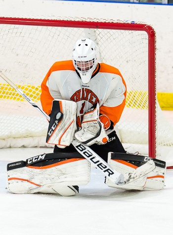Thayer's Jimmy Scannell makes a third period save in 3-2 win at Andover Wednesday.