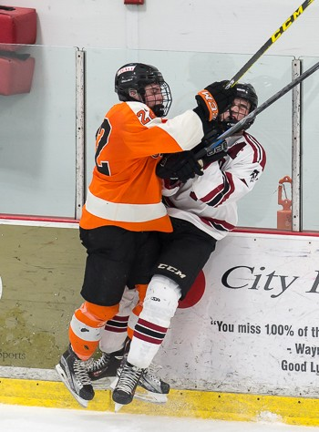 Thayer junior Casey Carreau -- the Tigers' leading goal scorer -- gets physical in Wednesday's 5-3 quarterfinal win over Tabor.
