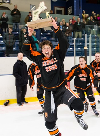 KUA senior forward Mike Lombardi hoists the hardware.