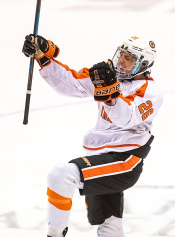 KUA's Paul Dore celebrates his game-winning goal, scored with 52 seconds left in the third period on Sunday March 3rd at Manchester, NH. The goal gave