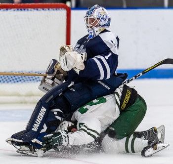Nobles' goalie Marc Smith, now a senior, finds a comfortable seat from which to take in some Flood-Marr action last December.