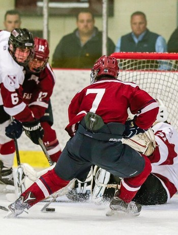 Gunnery senior G Trevin Kozlowski has his hands full with Avon's Patrick Harper in Wednesday action. Harper was kept off the board, but Avon won 5-3.