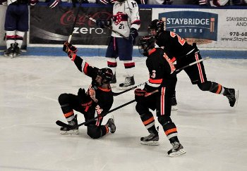 KUA junior Niko Rufo celebrates his third period goal against Holderness.