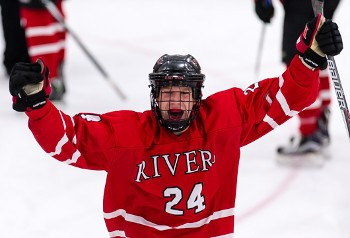 Rivers senior F Brett Rahbany celebrates after the final buzzer.
